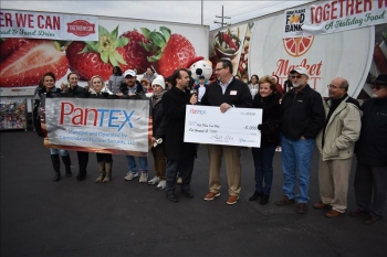 Pantex Plant employees volunteered at High Plains Food Bank's Together We Can Holiday Food and Fun Drive to gather and sort donations.