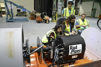 Heather Jones is shown second from left with other Carnegie Mellon University roboticists at work on the Radpiper. Also pictured, from left, are Siri Maley, Kenji Yonekawa, and David Kohanbash.