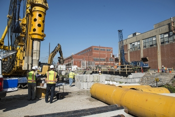 Employees dug up to 40 feet in the ground in some cases to pour concrete for the retaining wall.