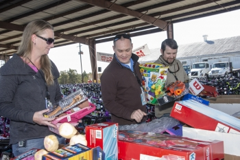 Savannah River Site employees sort toys prior to being loaded into several waiting trucks.