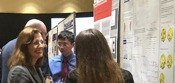 Dr. Kathleen Alexander and a University of Notre Dame student discuss research at the 2018 Stewardship Science Academic Programs Symposium poster session.