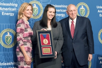 NNSA Administrator Lisa E. Gordon-Hagerty and Ambassador Linton F. Brooks presented Kaylyn Peters, center, with the achievement in a formal award ceremony at DOE Headquarters.