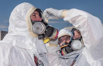 Radiological Assistance Program team members donned protective clothing and respirators in preparation for simulated entry into a contamination area.