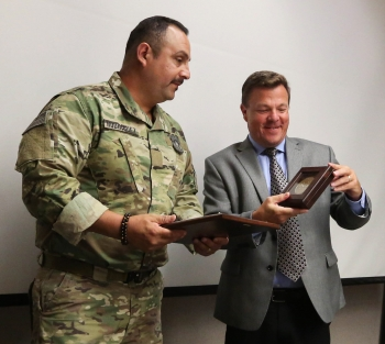 Livermore Field Office Manager Peter Rodrik delivers Rodriguez a citation from NNSA Administrator Lisa Gordon-Hagerty for his quick thinking during an incident in May.