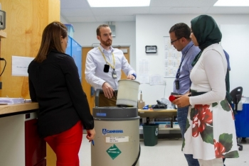 Participants learn how to use the Active Well Coincidence Counter, an IAEA inspection tool, to measure uranium at Los Alamos National Laboratory in July.