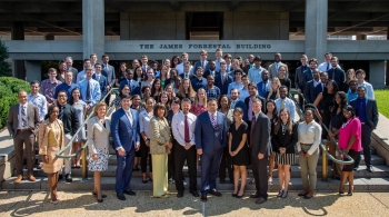 2018 MEISPP Interns pose in front of the DOE building with staff from the Office of Economic Impact and Diversity