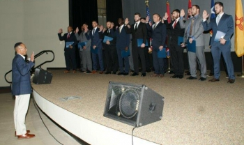 Vincent Fisher, NNSA's Assistant Deputy Administrator for Secure Transportation, swears in the new class of OST federal agents.