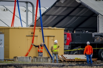 Paducah DOE Site workers prepare to load a Caterpillar SR4 diesel generator that was transferred to PACRO.