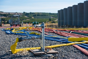 Surrounded by storage tanks and injection hoses, Pacific Northwest National Laboratory's subsurface imaging technology monitors the delivery of a phosphate solution for binding contaminants in the soil at the Hanford Site's 300 Area.