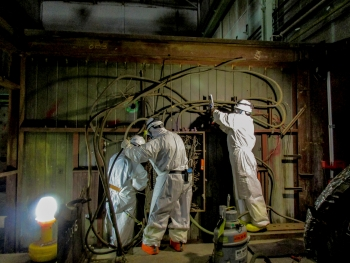 Four Rivers Nuclear Partnership workers remove instrument lines and electrical conduit from the C-400 Cleaning Building.
