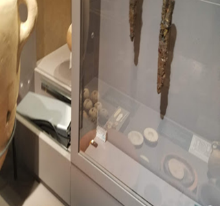 Showcase at the Museum of the Bible housing 2500-year-old spears, including a humidity sensor in the case and controller nested next to the case.