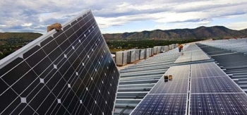 Photo of solar panels being installed.