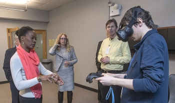 Raffaele Miceli demonstrates a virtual reality visualization to Danah Alexander, a senior project manager with Empire State Development, as Kerstin Kleese van Dam, director of Brookhaven Lab's Computational Science Initiative (CSI).