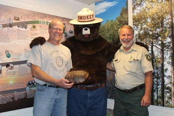 From left, Kurt Buhlmann, senior research associate at Savannah River Ecology Laboratory, holding a gopher tortoise shell, and Charlie Davis, forest ecologist with the U.S. Forest Service-Savannah River, pose with Smokey Bear.