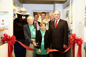 Officials gather for a ribbon cutting ceremony to open an environmental stewardship gallery at the SRS Museum.