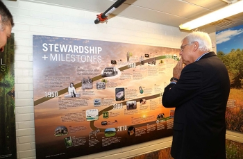 David Jameson, president and CEO of the Aiken Chamber of Commerce, studies the historical timeline of Savannah River Site accomplishments.