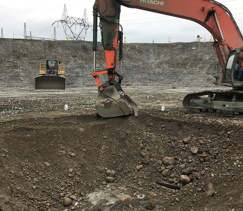 Workers used excavators to remove a 10-by-10-foot wooden structure, known as a crib, as well as some underground pipelines, debris, and potentially contaminated soil, reaching more than 45 feet below grade.
