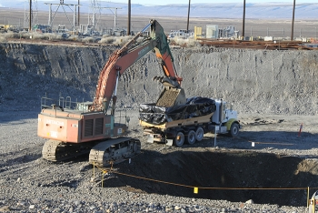 Debris and soil removed from a remediated waste site is packaged in large containers and transported to Hanford's onsite landfill for safe disposal.