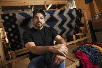 Los Alamos Lab Engineer Donald Sandoval with his loom.