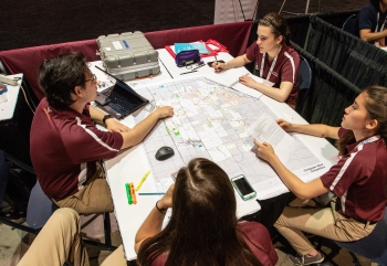 Students work on their siting plans for wind turbines in their team booths at the Collegiate Wind Competition 2018 n Chicago on May 9, 2018.