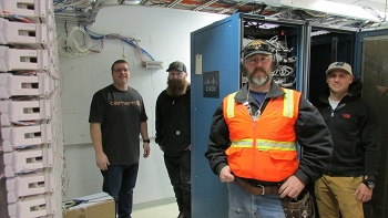 Robin Maples, Zack Larson, Joe Jensen, and Quinn Bragg with Mission Support Alliance were among the technicians who replaced access layer switches throughout the Hanford Site.