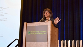 Dr. Valerie Montgomery Rice stands at the podium, delivering the keynote address at the Clean Energy Education & Empowerment (C3E) symposium on December 3-4, 2018