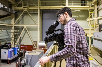 High school senior Micah Gilbert works on his skills as a videographer during Job Shadow Day at DOE's Savannah River Site (SRS). Dozens of local students visit SRS each year to explore a potential career.