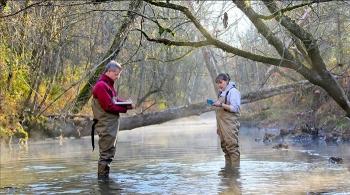 Oak Ridge National Laboratory scientists gather sampling data from the East Fork Poplar Creek.
