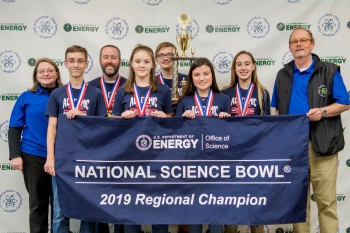 Calloway County Middle School, First Place: Front row, pictured left to right: Ethan Cain, Rebecca Grosz, Drake Calhoon, Emma Arnett. Back Row: Jennifer Woodard, DOE Paducah Site Lead, Scott Pile, Calloway County Middle School Coach, Isaac Martin, Buz Smi