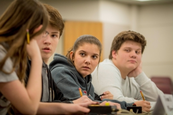 McCracken County High School students Evie Dukes, Mason Wooten, Ella McBee and Jake Mitchell compete in a quick-recall, fast-paced question-and-answer contest at this year's DOE Regional Science Bowl.