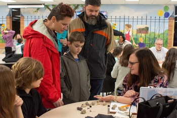 Elizabeth Phillips talks with students about her work as a geologist at the Oak Ridge Office of Environmental Management. She helped them examine the difference between fossils, minerals, gold, and fool's gold.