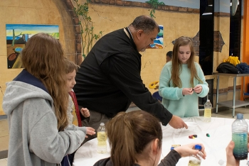 The Oak Ridge Office of Environmental Management's Leon Duquella shows students how to build lava lamps.