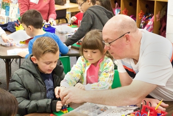 "Savannah River Nuclear Solutions engineer Steve Watson helps Millbrook Elementary School students create battery-powered Lego windmills during ""Science Enrichment Day"" at a school near the Savannah River Site."