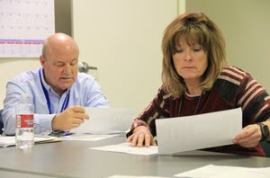 Spent Nuclear Fuel Support Manager Mark Stubblefield and Nuclear Facility Manager Pat Spaulding review maintenance logs of repairs.