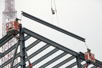 Contractors place the last piece of structural frame on the Mechanical Electrical Building at the Uranium Processing Facility at Y-12 National Security Complex in Oak Ridge, Tennessee.