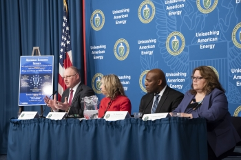 NNSA's Jim McConnell, left, joined a panel about the pros and cons of the Senior Executive Service.