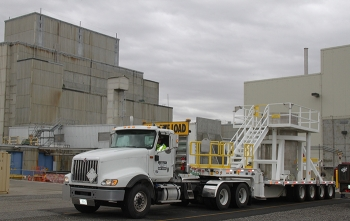 An engineered container filled with radioactive sludge is prepared for transport from the 105-K West Annex to safer storage in the central part of the Hanford Site. Sludge removal from the basin is expected to be complete by the end of the year, reducing