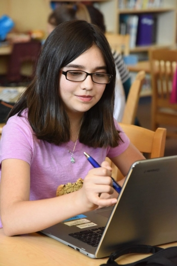 An Idaho student participates in a Girls Who Code training event. This program also works to close the gender gap in technology career fields.