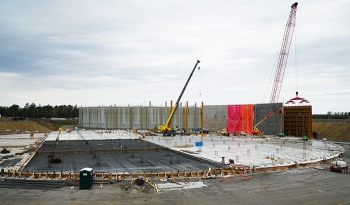 A photo from March 2019 shows progress to the Saltstone Disposal Unit (SDU) 7 outer shell construction. SDU 6 is in the background.