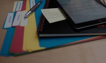 photo of acquisition folders sitting on desk
