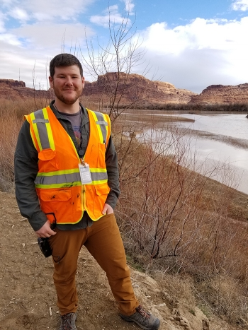 Alex McCarty, pictured here along the Colorado River, joined the Moab Uranium Mill Tailings Remedial Action Project in April last year. He is the technical assistance contractor's environmental analyst.