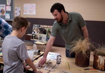 Botanist David Holbrook showed students the tools used to measure large spaces like pastures.