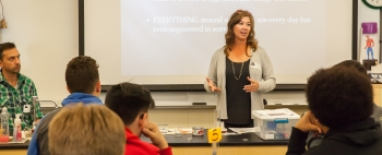 Nuclear Waste Partnership Fire Marshal Brenda Larsen discusses fire protection engineering at Hobbs Freshman School in Hobbs, New Mexico during Engineers Week.