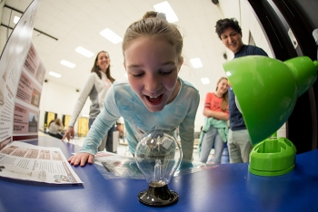 Students from Joe Stanley Smith Elementary in Carlsbad take a closer look at a Crookes radiometer. Also known as a light mill, the vanes of the radiometer spin when exposed to light, providing a quantitative measurement of electromagnetic radiation.