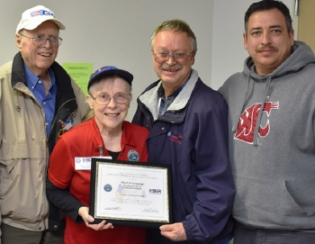 Jim Rabideau and Judy West, left, of the Employer Support of the Guard and Reserve program, present the Patriot Award to Mark Cranston, an industrial hygiene supervisor for Washington River Protection Solutions (WRPS) at the Hanford Site.