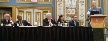 EM Consolidated Business Center Acquisition Integration Lead Aaron Deckard discusses future EM contracting opportunities during a panel session at the Reservation Economic Summit 2019. Other panelists included, from left, Charlie Smith, director of the DO
