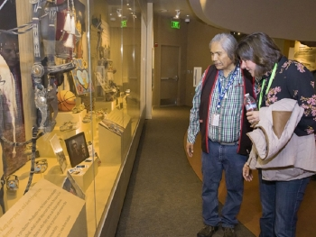Wanapum Band Tribal Elder Rex Buck, Jr. and EM Assistant Secretary Anne White view a display of artifacts at the Wanapum Heritage Center.