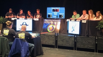 Teams from Wheelersburg, left, and Zane Trace compete in the championship match of the South Central Ohio Regional Science Bowl at Shawnee State University on Friday, March 15, 2019.  Wheelersburg won the title match 46-12.