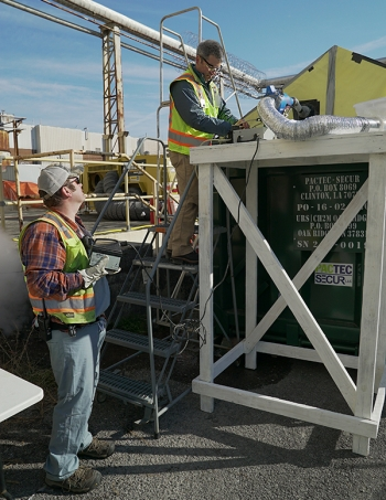 Idaho National Laboratory and UCOR employees work together during the fogging demonstration at the Oak Ridge Site.