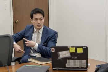 Michael Yo tells fellow employees about his international efforts during a lunchtime event in Washington, D.C.